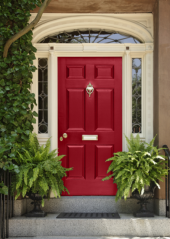 A door painted a bold shade of red can give your home a warm, formal feeling on the outside
