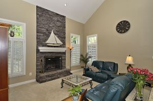 Floor to Ceiling Stone Fireplace in Family Room